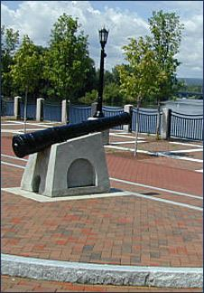 Schenectady riverwalk with statue of a cannon