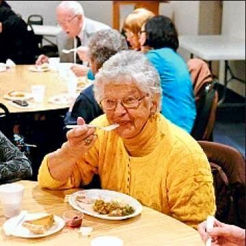 enjoying a meal at the senior center